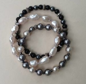 Three Bracelets Pearls, Black Onyx, and Bali Beads by Mary Jane St Amour